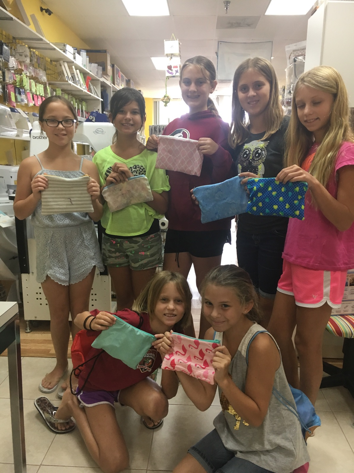This group of young ladies, all made zippered bags during a private lesson with Miss Lori