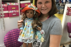 Amy Grace loves to sew doll clothes.