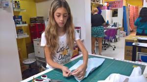 Juvia starts designing her cat's new dress