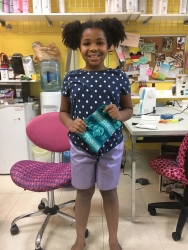 Maya made the shorts and bag she is pictured with