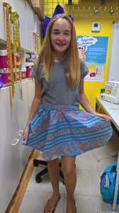 Amanda in her apron, her first sewing project.